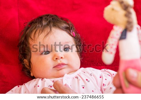 Portrait of an adorable baby lying on the bed