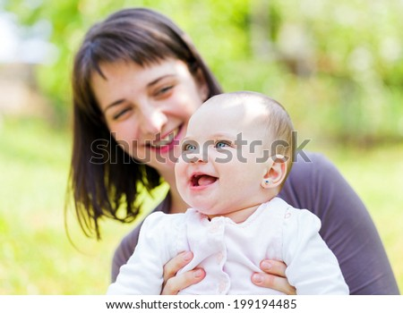 Portrait of an adorable baby with her mother