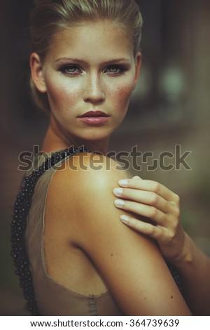Portrait of an adorable blond woman - stock photo