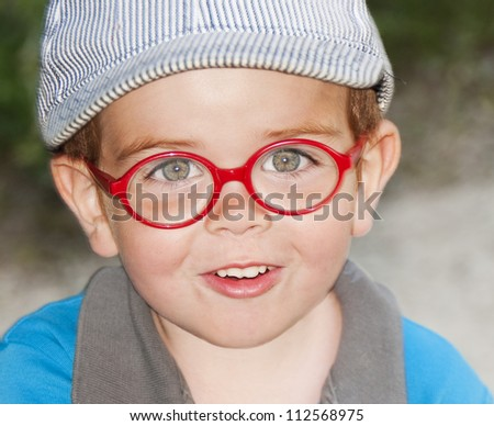 Portrait of an adorable  child with red glasses