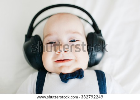 Portrait of an adorable dj baby boy with headphones
