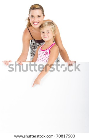 Portrait of an adorable girl and mother holding blank billboard on white background - stock photo