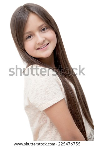 Portrait of an adorable girl smiling at the camera on a white background - stock photo