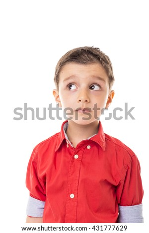 Portrait of an adorable little boy with wondering expression isolated on white background