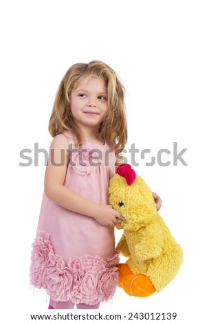 Portrait of an adorable little girl holding a yellow plush toy over white background - stock photo