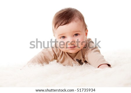 Portrait of an adorable little 6 months old baby with sad face. White background, studio shot. - stock photo