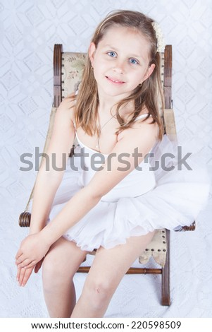 Portrait of an adorable preschool age girl playing dress up wearing a ballet tutu, isolated on white - stock photo