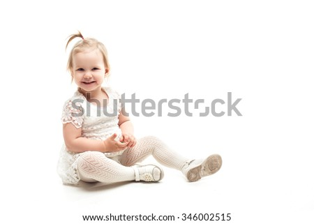 Portrait of an adorable preschool age girl smiling , isolated on white - stock photo