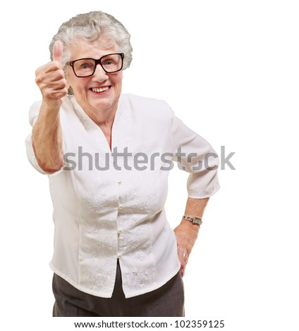 portrait of an adorable senior woman doing a good gesture over a white background - stock photo