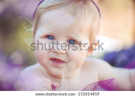 Portrait of an adorable smiling girl in lavender field - stock photo