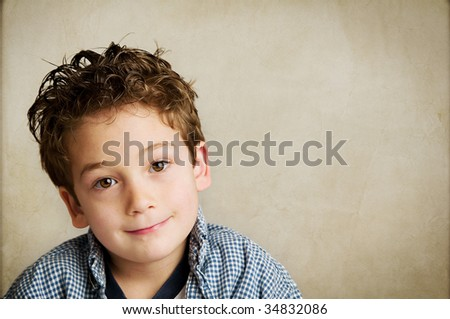 Portrait of an adorable young boy - stock photo
