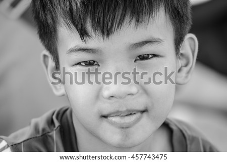 Portrait of an adorable young  boy with black hair In the mood to depression.Photo toned style black white. - stock photo