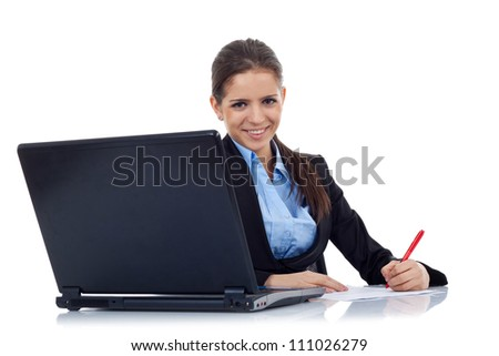 Portrait of an adorable young business woman working at her desk with a laptop and paperwork. Isolated on white - stock photo