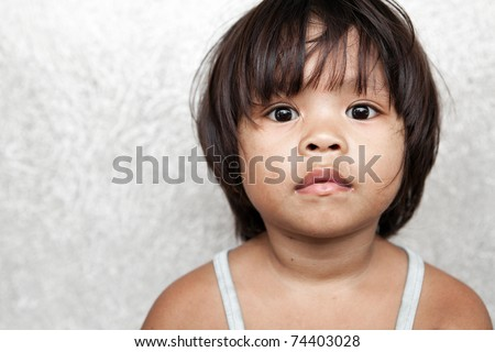 Portrait of an adorable young girl in the Philippines - stock photo
