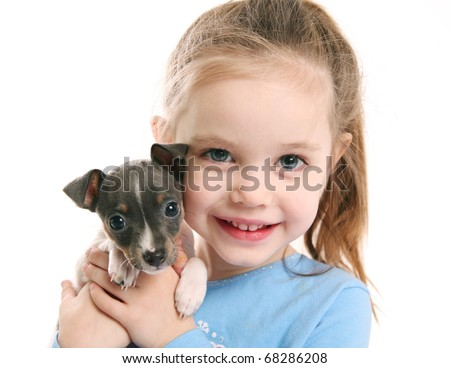 Portrait of an adorable young girl smiling holding a cute tiny rat terrier puppy - stock photo