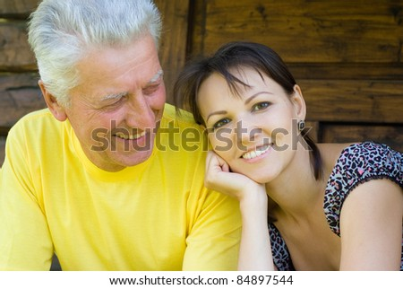 portrait of an adult daughter and dad - stock photo