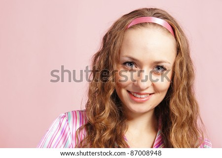 portrait of an adult girl on pink background - stock photo