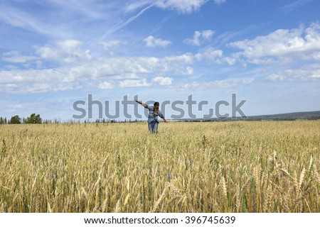 Portrait of an adult man in a wheat field in the aviator image on a sunny day - stock photo