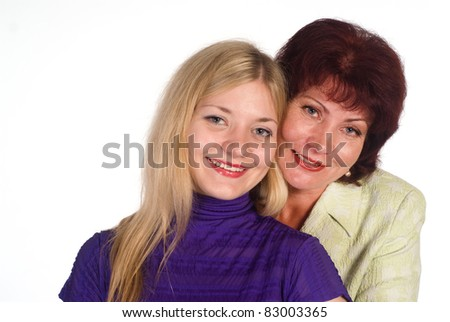portrait of an adult mom and daughter on white