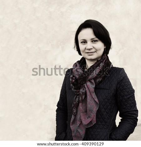 Portrait of an adult woman in a dark blue jacket and cravat - stock photo