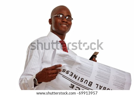 Portrait of an African American businessman reading newspaper - stock photo