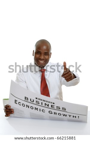 Portrait of an African American businessman reading newspaper sitting at the table - stock photo
