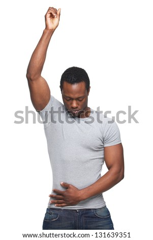 Portrait of an african american man with hand up in air - stock photo