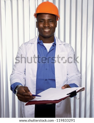 Portrait of an African American with folder - stock photo