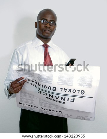 Portrait of an African American with newspaper - stock photo