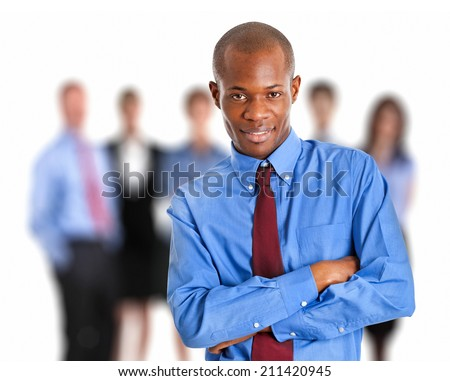 Portrait of an african businessman in front of his team  - stock photo