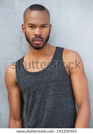 Portrait of an african male fashion model posing outdoors - stock photo