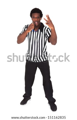 Portrait Of An African Referee Gesturing Over White Background - stock photo