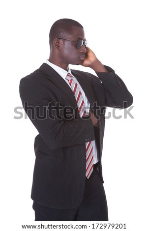 Portrait Of An African Young Man In Suit Wearing Sunglasses Over White Background - stock photo