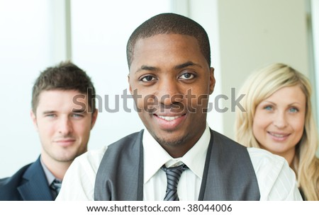 Portrait of an Afro-American businessman with his colleagues in folded arms - stock photo