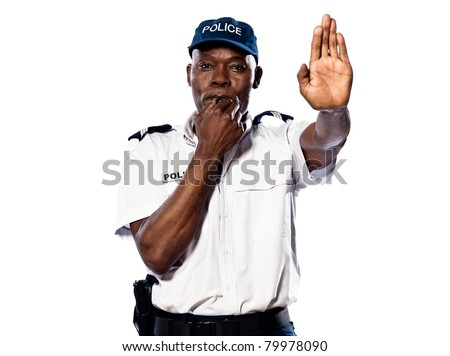 "Portrait of an Afro American police officer holding a hand up to motion ""stop"" while blowing whistle on white background - stock photo"