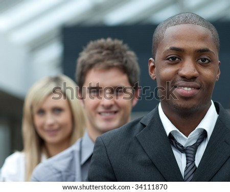 Portrait of an Afro-American young businessman leading his team - stock photo