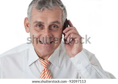 Portrait of an aged business man calling using mobile phone - stock photo