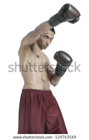 Portrait of an aggressive Asian boxer punching over a white background