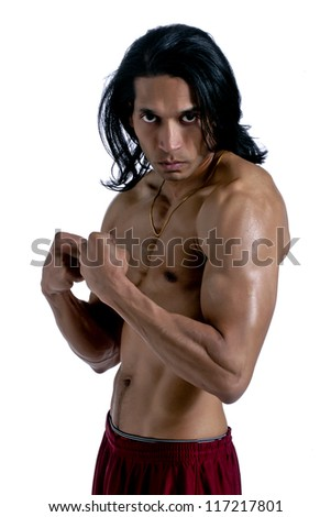 Portrait of an aggressive muscular man over a white background - stock photo