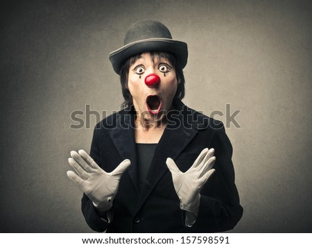 portrait of an amazed clown with open mouth - stock photo
