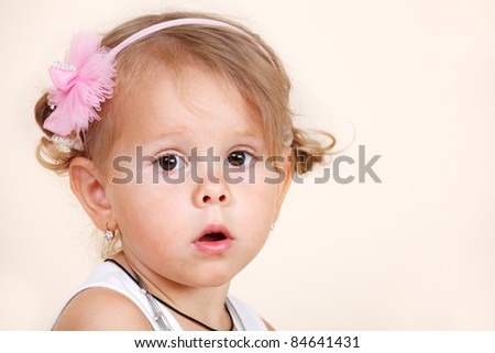 Portrait of an amazed toddler girl