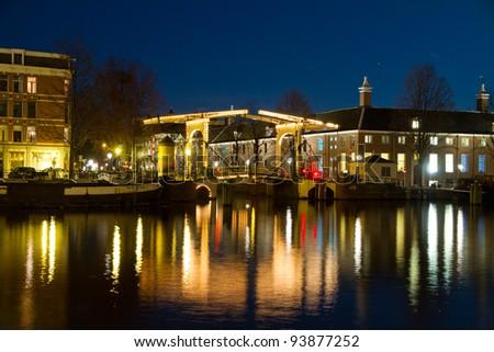 portrait of an amsterdam bridge by night - stock photo