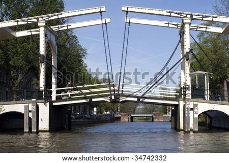 portrait of an amsterdam bridge seen from ocean - stock photo