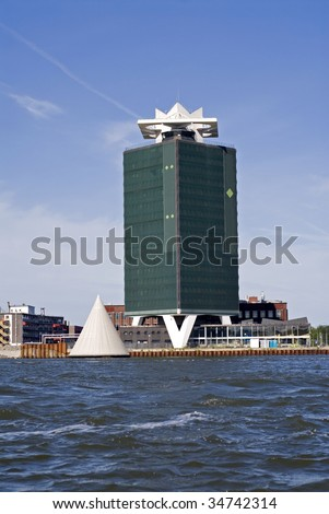 portrait of an amsterdam building seen from ocean - stock photo
