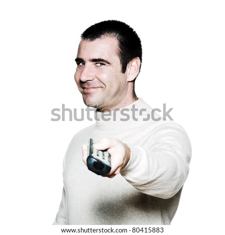 Portrait of an amusing mature man holding remote control in studio on white isolated background - stock photo