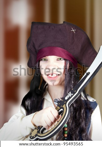 Portrait of an angry boy dressed like a medieval pirate - stock photo