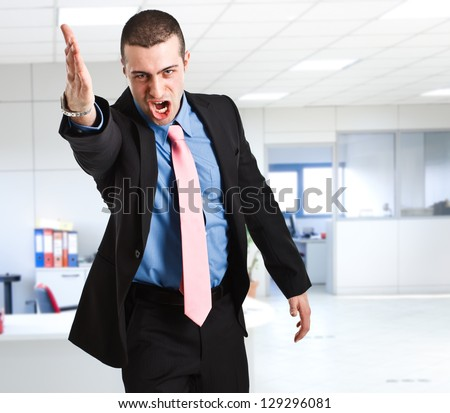 Portrait of an angry businessman - stock photo