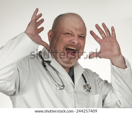 Portrait of an angry doctor - stock photo
