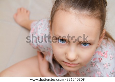Portrait of an angry girl  - stock photo