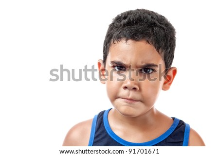 Portrait of an angry Latin boy isolated on white - stock photo